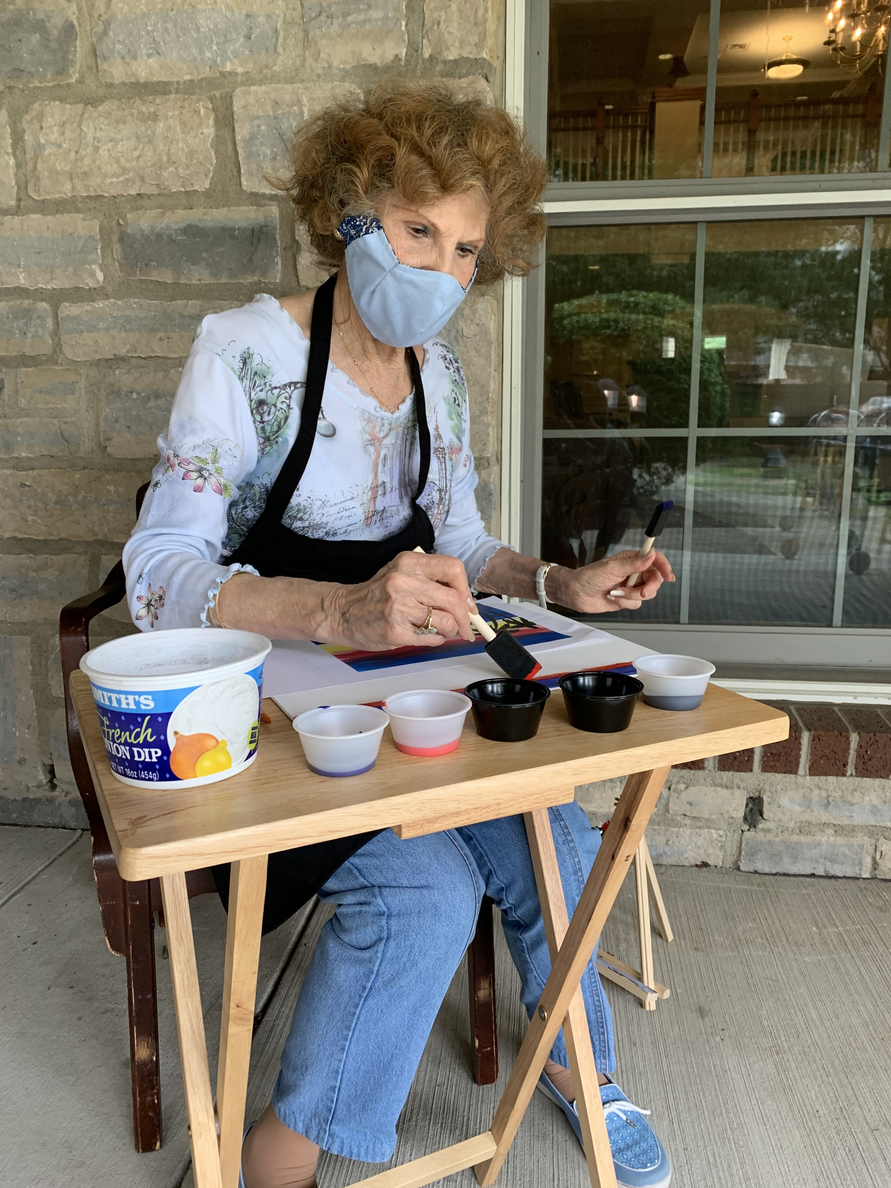 Creekside resident of Wexner Heritage Village painting.