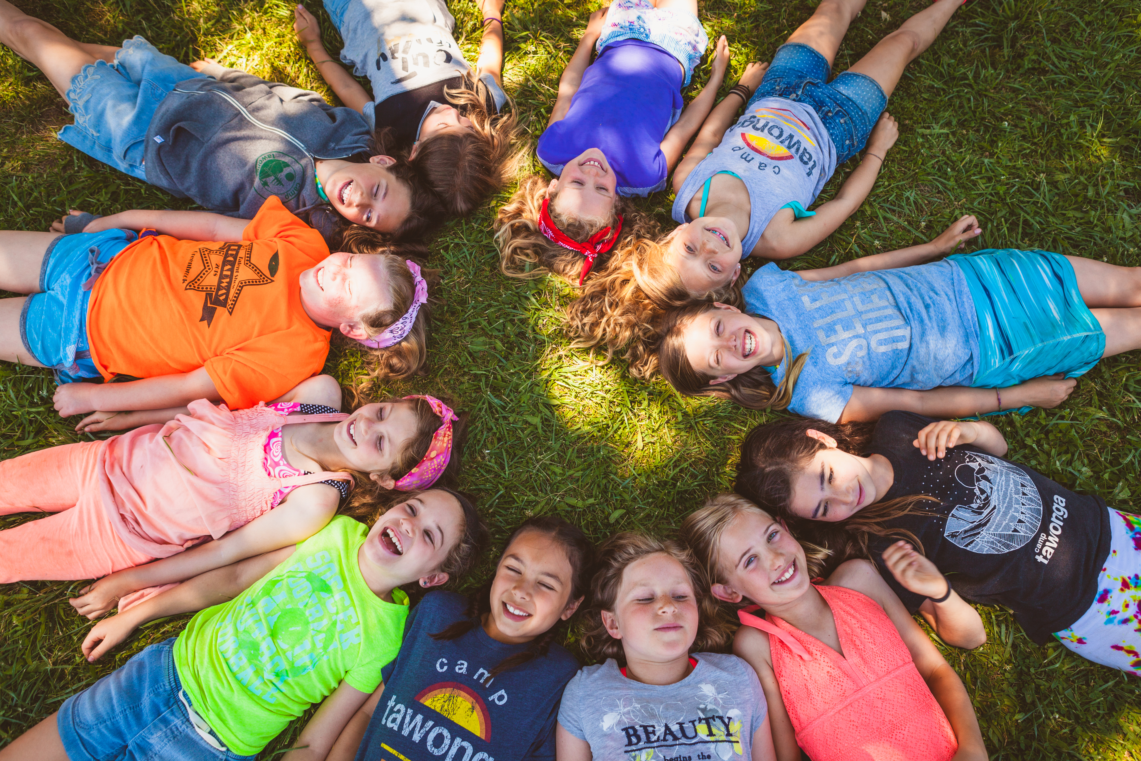 A group of kids who attended Jewish summer camp smiling